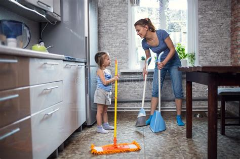 Mother Daughter Wash The Floor At Home Stock Image Luxury Bathroom Shower Curtain Sets Croydex Round Rod And Rings Chrome Blinds Parts Kohls Curtains Room Darkening Elbow Bracket Medallion Holdbacks C Hanging In Concrete Wall