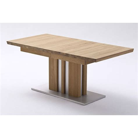 oak and steel dining table bolzano extendable dining table in solid oak with steel