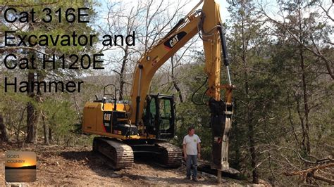 cat  excavator breaking rock   cat  hammer youtube