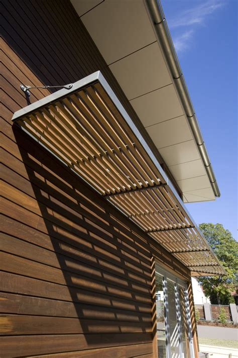 awning metal frame  wooden slats house awnings house exterior shade structure