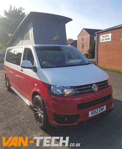 sold vw transporter  camper van white  red  tone