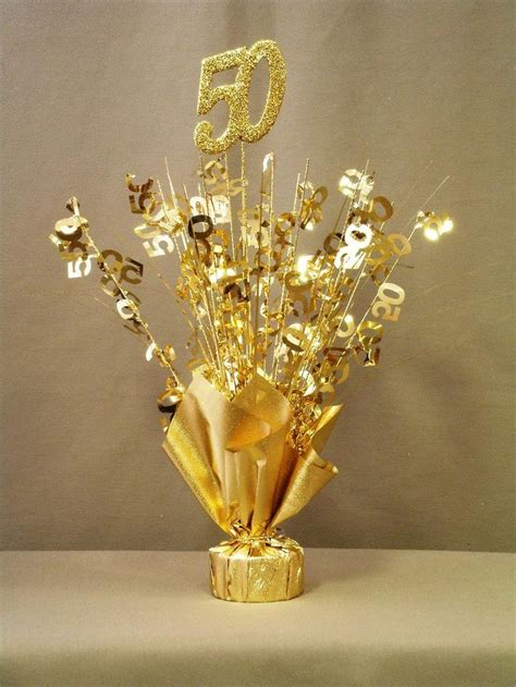 gold  table centerpiece mom  dad anniversary