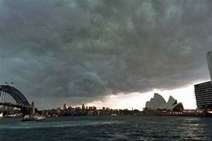 Storm clouds gather over Sydney Opera House - ABC News ...