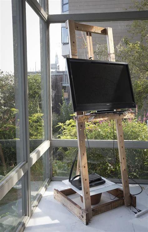 tv display ideas  pinterest leather poof tv