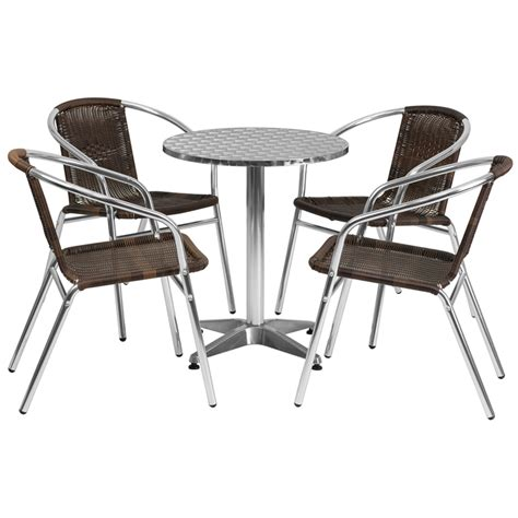 brown walnut rattan chairs with stainless steel top set in