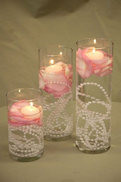 floating candles with pearls so pretty for wedding