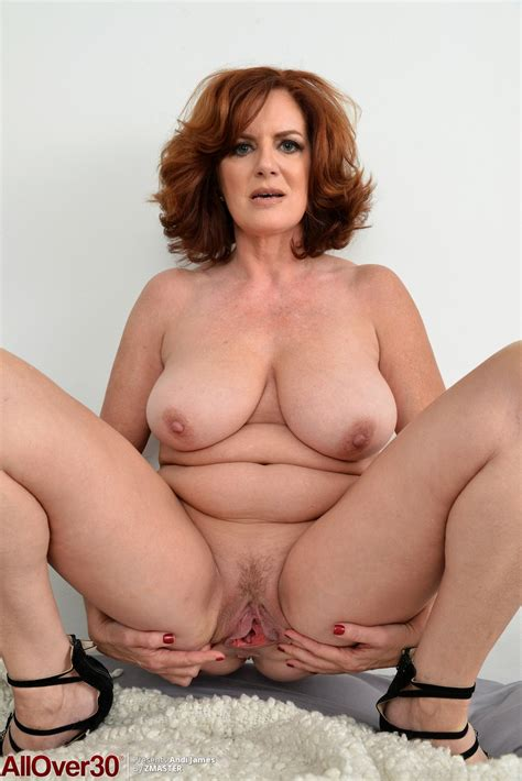 Hot Redhead Ature Andi James Sheds Sexy Underwear To