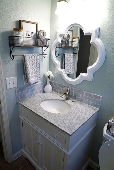 small guest bathroom decorating ideas 25 best ideas about mirror hanging on small