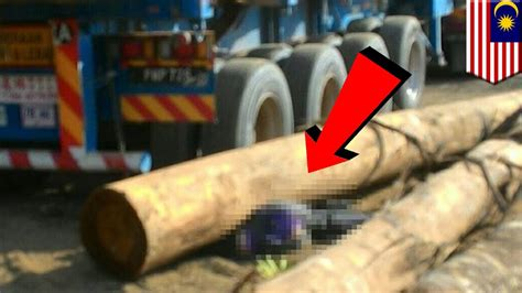 Malaysian Lorry Driver Crushed By