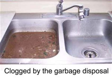 clogged kitchen sink with garbage disposal garbage disposal smart plumbers rooters