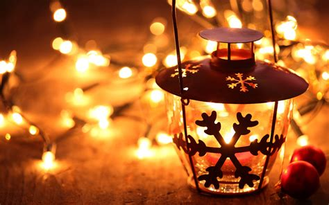 christmas lanterns snowflake lantern on wooden floor with yellow candle light christmas hd wallpaper widescreen