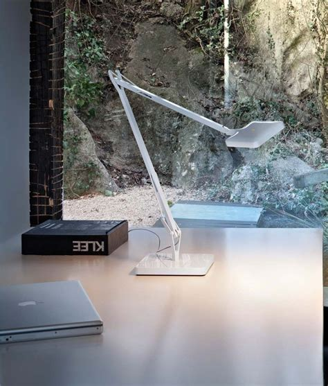 The light, which is designed and created in italy, comes in five models (base, two desk mount versions, wall bracket, and desk clamp), and is equipped with 30 top led 2700k 275lm cri 95. Flos Kelvin LED Table Lamp