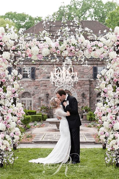 White And Pink Flower Decorated Outdoor Wedding Ceremony