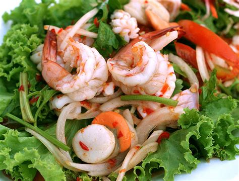 Cooking shrimp in their shells keeps them firm and meaty, plus it adds a little briny flavor to the noodles. Spicy Seafood Salad Recipes (Yum Talay : ยำทะเล) | Thai Food Recipes Menu, Thai Noodles, Thai ...