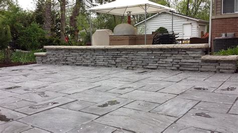 Unilock Rivercrest by Unilock S Rivenstone Patio With Rivercrest Seat Wall With