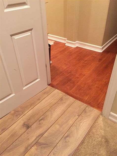 ok flooring is using 2 different wood floors ok from hallway to bedroom