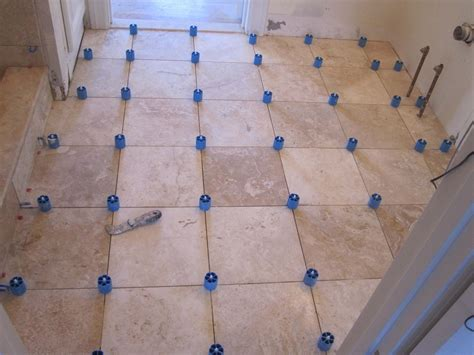 Install Tile In Bathroom by How To Install Travertine Tile With Proleveling System