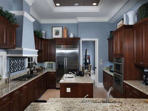 Blue Kitchen Walls With Brown Cabinets by I Like This Wall Color And It S That The Floor Is