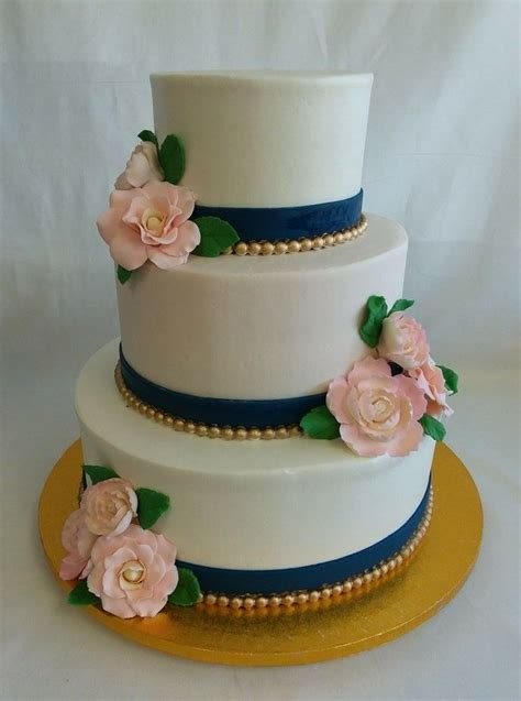 romantic white wedding cake  blush garden roses navy