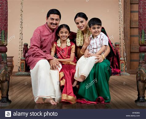 portrait   south indian family sitting   jhula stock