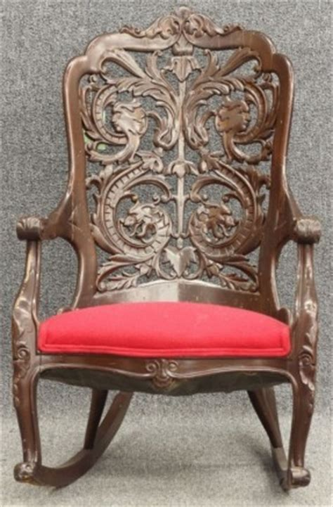 pair of upholstered inlaid mahogany wing mahogany arm chair thing