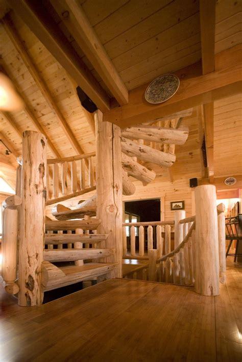 custom  log spiral staircase  hand scraped wood