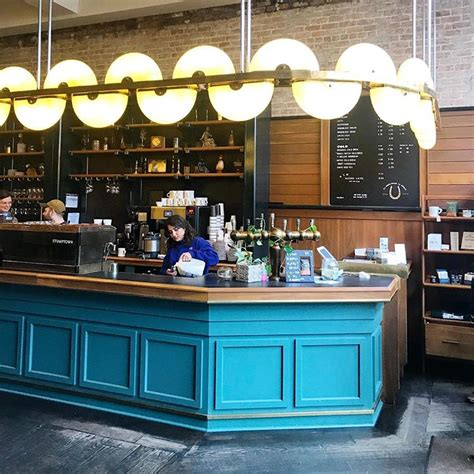 Create a striking effect with the layered and wooden touch ceiling at your coffee shop. 50 Cool Coffee Shop Interior Decor Ideas - DigsDigs