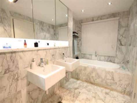 modern bathroom design  recessed bath  marble