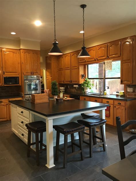 Updated kitchen with new white island, original honey oak
