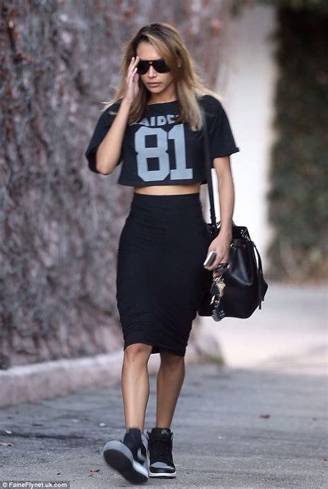 Naya Rivera steps out in cropped Oakland Raiders T-shirt and tight pencil skirt | Daily Mail Online