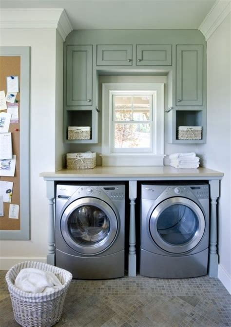 cabinets over washer and dryer tile above washer and dryer fake window between cabinets
