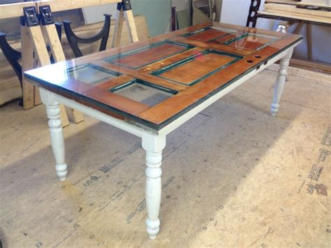tables made from doors he saws an door into pieces to create an