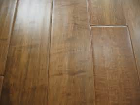 scraped smooth and distressed wide plank wood flooring showroom