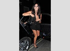 Pascal Craymer risks a wardrobe malfunction as she puts on