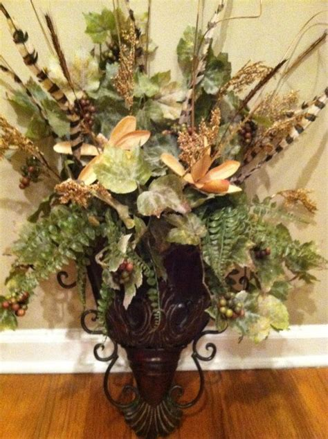 elegant wall sconce floral arrangement ferns