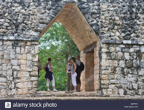 Group Of Tourists Under Famous Mayan Corbel Arch At Ek