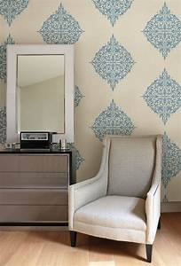 Turquoise feature wall with modern medallion wallpaper