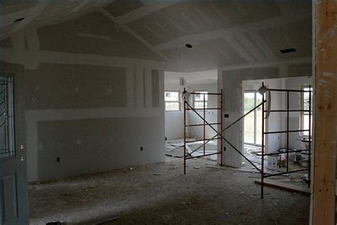 how to hang drywall over the top of plaster ehow