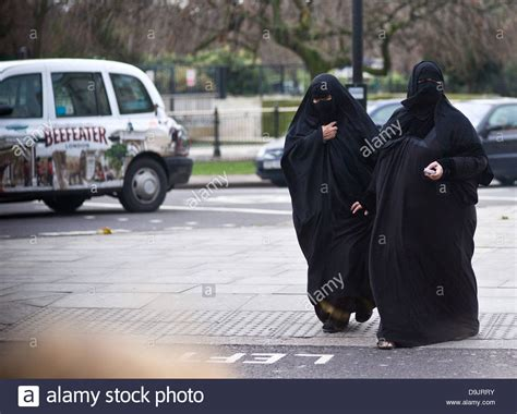 young woman wearing burka black hijab london stock photo