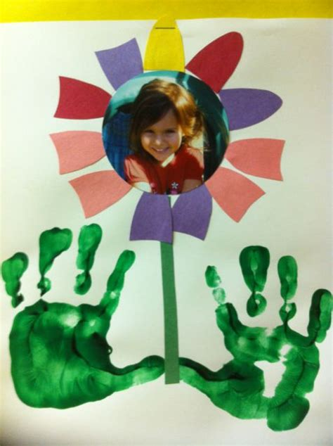 cute flower frame  hand prints  grass