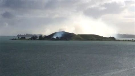 Raw: Smoke billows from Auckland's Browns Island as fire ...