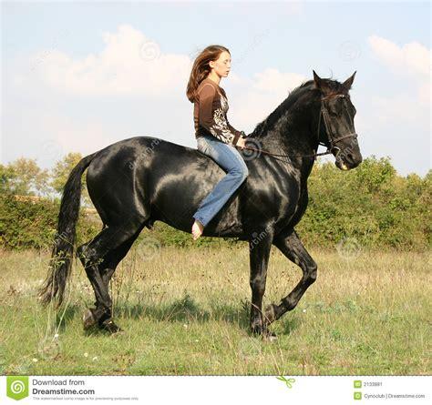 pretty woman  black horse stock image image