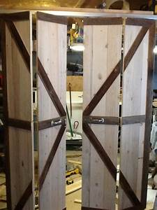 double bi fold barn doors opened quotbarn doorquot decor With barn wood bifold doors