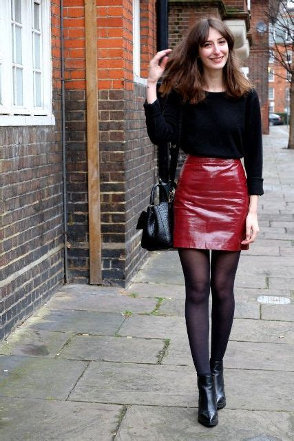 Picture Of With black shirt black tights ankle boots and leather bag