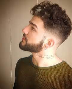 Curly Men Hairstyle Shaved Sides