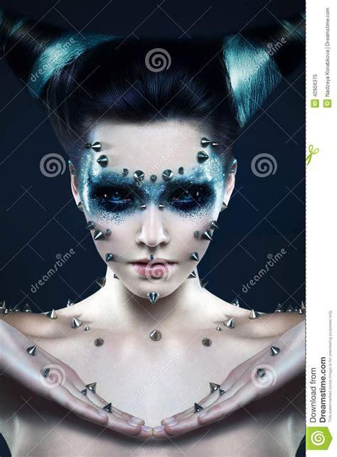 demon girl  spikes   face  body stock photo