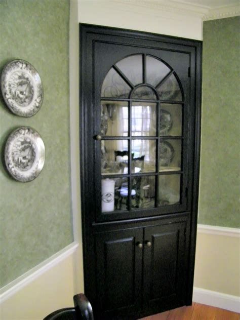 black corner cabinet maison decor black paint updates a traditional dining room