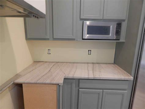 do quartz countertops stain cabinets with waypoint a counter point to granite kitchen