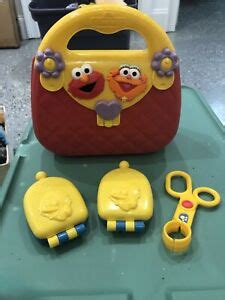 Games and activities available in preschool mode: Sesame Street My First Purse Pink Plastic Elmo Zoe ...
