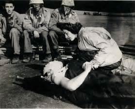 Nurse Helping Soldier